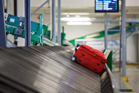 handling: Baggage on conveyor belt at the airport - selective focus Editorial