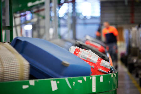 sorting: Baggage on conveyor belt at the airport - selective focus Editorial