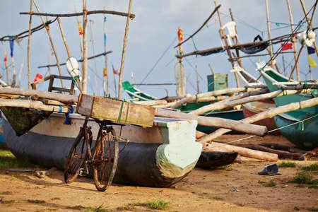fishery: Bicycle and fishing boats in port - Sri Lanka Stock Photo