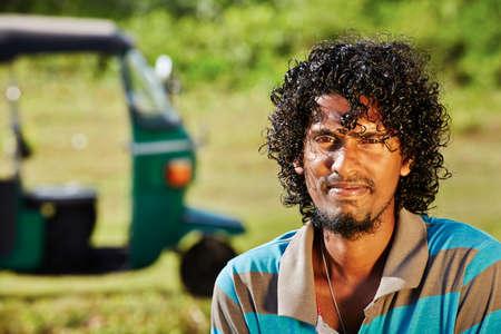 three palm trees: Young tuk-tuk driver in Sri Lanka.