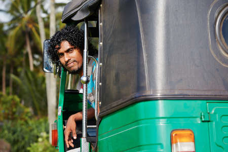 Young tuk-tuk driver in Sri Lanka. photo
