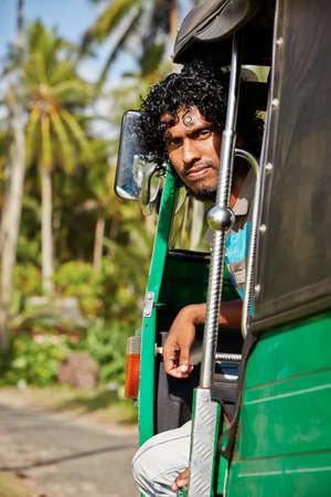 autorick: Young tuk-tuk driver in Sri Lanka.