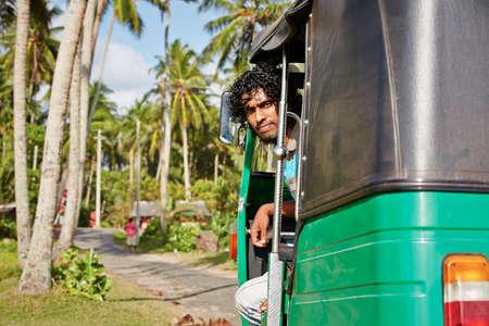 tuktuk: Young tuk-tuk driver in Sri Lanka.