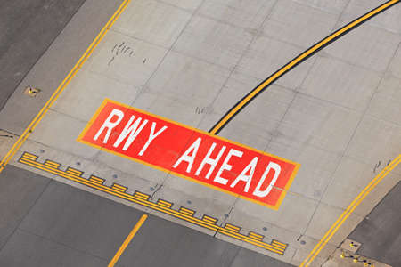 airport runway: Airfield - marking on taxiway is heading to runway  Stock Photo