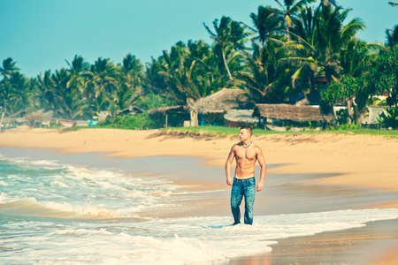 Muscular man on the beach - Sri Lanka photo