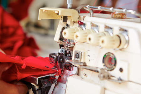 sartorial: Sewing machine in small textile factory - selective focus  Stock Photo