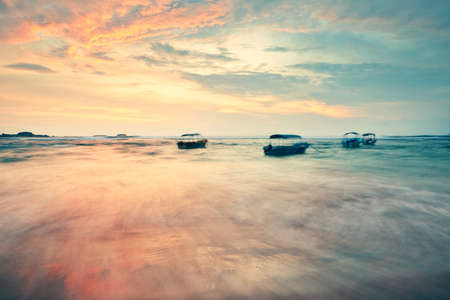 Abstract shot of boats on the shore in Sri Lanka. photo