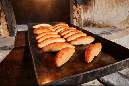 baking oven: Traditional preparation of rolls in the bakery. Stock Photo