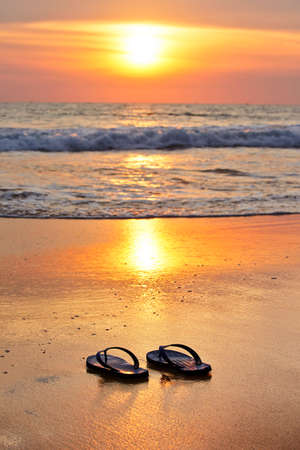 flip flop: Flip flops on the beach at sunset