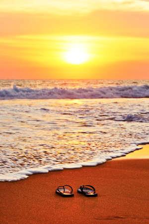 flipflops: Flip flops on the beach at sunset