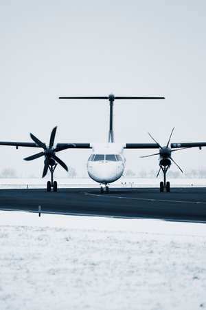 airplane take off: Airplane is taxiing on the airport in winter  Stock Photo