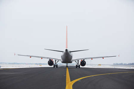 airplane landing: Airplane is taxiing on the airport in winter  Stock Photo