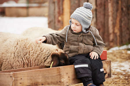 Little boy on the farm in winter photo