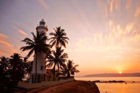 fortress: Lighthouse in fort in Galle at sunrise - Sri Lanka