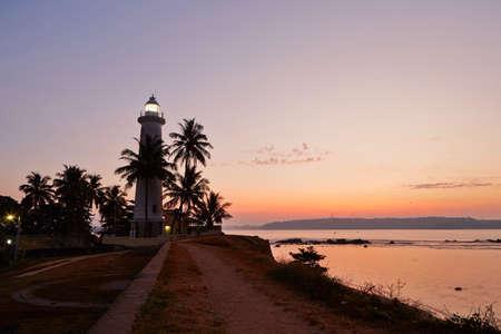galle: Lighthouse in fort in Galle at sunrise - Sri Lanka