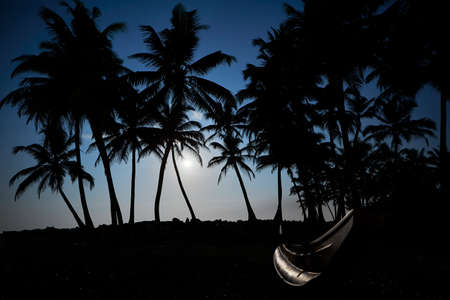 Night photo with full moon above sea in Sri Lanka. photo