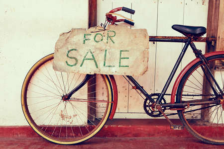 Abandoned bicycle for sale - retro color photo