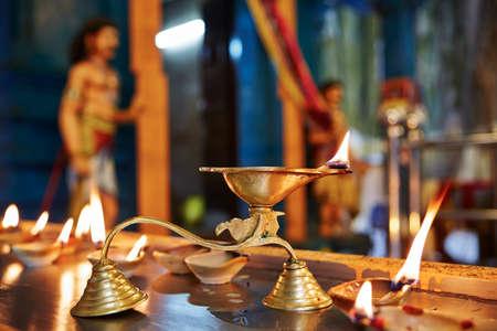malaysia culture: Candles in hindu temple - Kuala Lumpur, Malaysia