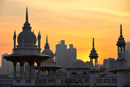 malaysia city: Towers of the historical building railway station in Kuala Lumpur at sunrise.