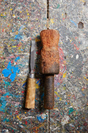 Wooden hammer and chisel in old carpentry workshop photo