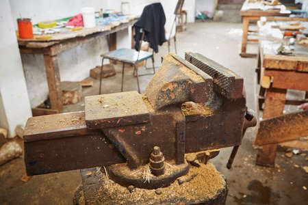 Metal vice in old carpentry workshop - selective focus photo