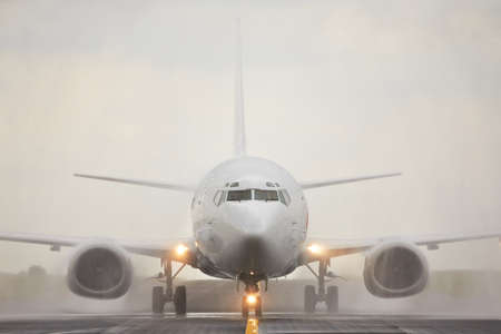 weather front: Airplane is landing in bad weather