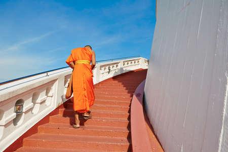 buddhist monk: Monk is walking to the temple Wat Saket (Golden mountain) in Bangkok