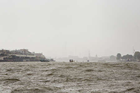 Heavy rain on Chao Phraya river in Bangkok photo