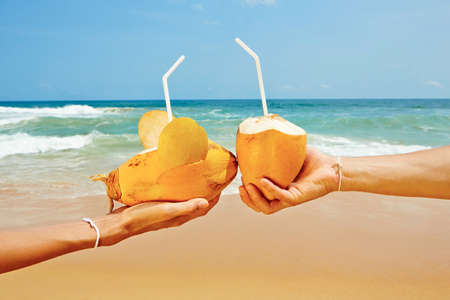 Hands Of The Couple With Coconut Drinks Photo