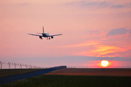 approaching: Airplane is landing at the airport