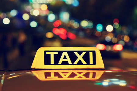 taxi sign: Taxi car on the street at night