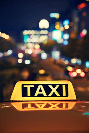 Taxi car on the street at night - Wenceslas Square, Prague photo
