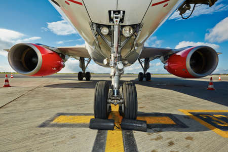 Undercarriage of the aircraft at the airport. Stock Photo
