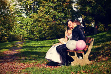 newlyweds: Wedding day - young couple in park Stock Photo