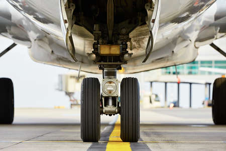 plane landing: Airport - nose wheel of the aircraft Stock Photo