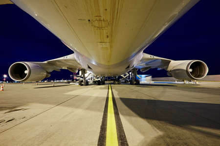 Loading of cargo to the freight aircraft. Stock Photo