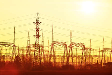 industry moody: Silhouette electricity pylons during sunset - Czech Republic