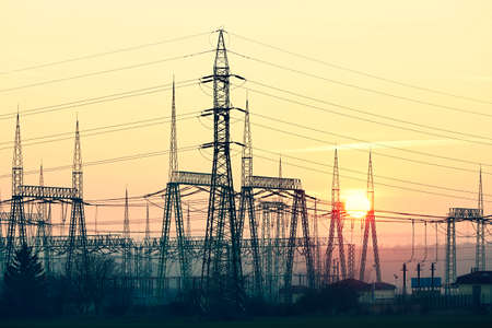 high voltage current: Silhouette electricity pylons during sunset - Czech Republic