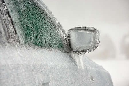 frost covered: Car on the street covered by icy rain. Stock Photo