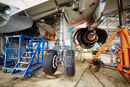 plane landing: Chassis of the airplane under heavy maintenance Stock Photo