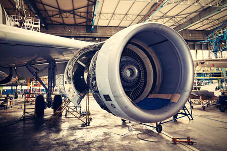 Engine of the airplane under heavy maintenance 免版税图像