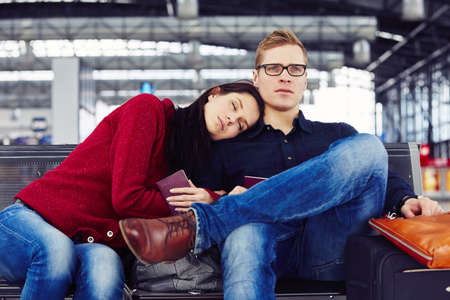 Couple waiting for flight at the airport Stock Photo