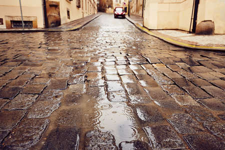 Street in the heavy rain - Prague, Czech Republic photo
