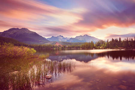 sunrise mountain: Wonderful sunrise in Strbske pleso in Slovakia. Mountain lake in National Park High Tatras.