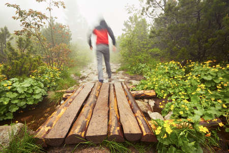 blurred motion: Travelers hiking in the mountains - blurred motion