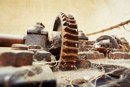 abandoned factory: Cog wheel with cobweb in abandoned factory Stock Photo
