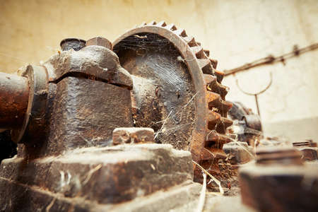 cog wheel: Cog wheel with cobweb in abandoned factory Stock Photo