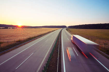 Traffic on the highway at the sunrise Stock Photo