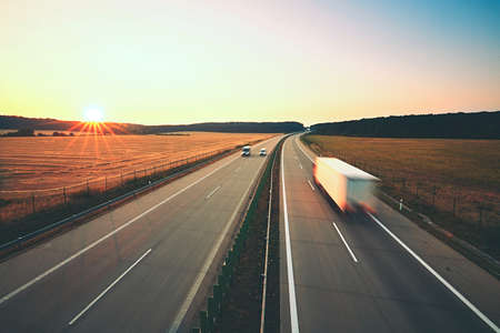 landscape rural: Traffic on the highway at the sunrise Stock Photo