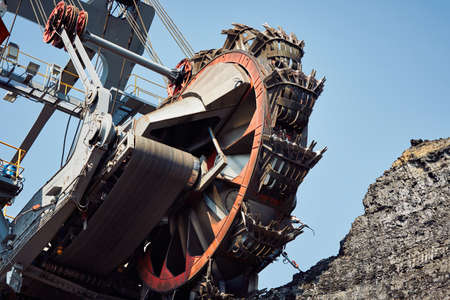dirty environment: Huge mining machine in the coal mine